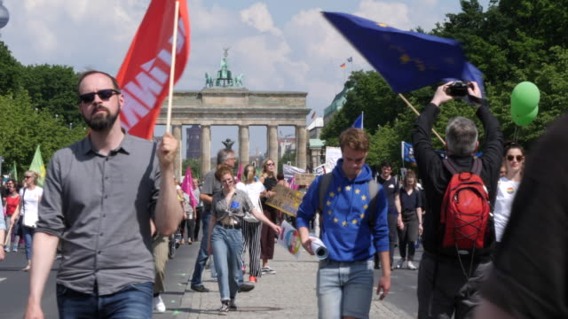 """protesters take part in the """"one europe for all"""" march on may 19, 2019 in berlin, germany. in the background the brandenburg gate can be seen.... - populism stock videos & royalty-free footage"""