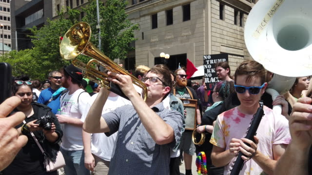 protesters taunt the kkk with a song from the wizard of oz hundreds of counter protesters including the nation of islam the dayton chapter of the... - ku klux klan stock videos and b-roll footage