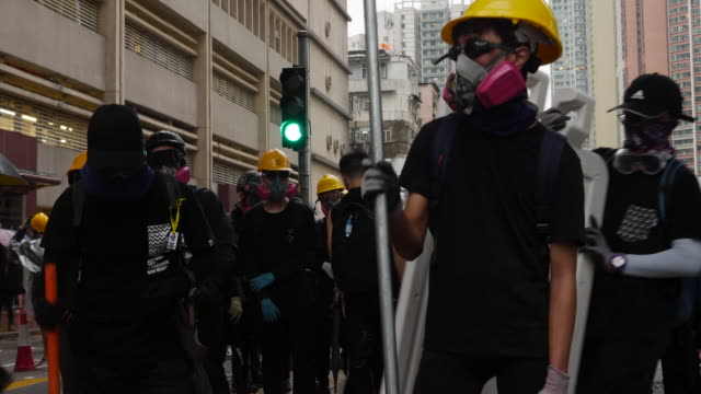 protesters taunting and clashing with riot police in hong kong - obscene gesture stock videos and b-roll footage