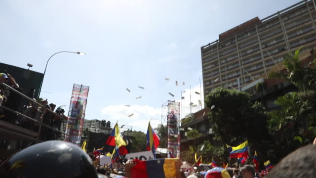 protesters throwing money into air as it has little value at anti government rally in caracas - socialism stock videos & royalty-free footage