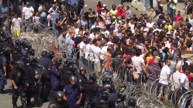 protesters try to cross from wire fences around prime ministry building during a protest against the ongoing garbage crisis and corruptions on august... - protestor stock videos & royalty-free footage
