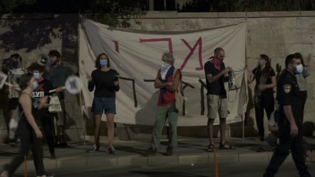 """protesters use bullhorns to shout """"we will not allow to establish a dictatorship"""" as they stand in front of a large banner which reads """"civil revolt""""... - eddie large stock videos & royalty-free footage"""