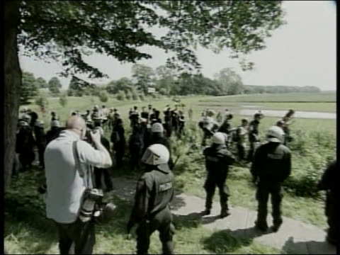 protesters walk along a road during the 2007 g8 summit in heiligendamn germany - (war or terrorism or election or government or illness or news event or speech or politics or politician or conflict or military or extreme weather or business or economy) and not usa stock-videos und b-roll-filmmaterial