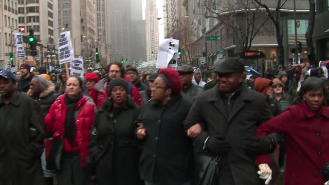 WGN Protesters Walk Down Michigan Avenue on Black Friday in the wake of the release of the video showing the shooting of 17yearold Laquan McDonald by...