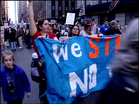 wgn protesters walk down street with antiwar signs on march 20 2004 in chicago illinois - 2001年~ アフガニスタン紛争点の映像素材/bロール