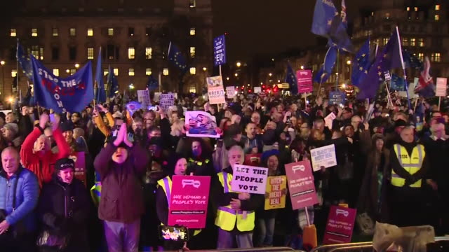 protesters watch brexit deal vote result on big screens outside parliament celebrations and chants for people's vote - loss stock videos & royalty-free footage