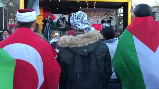 protesters wave palestinian flags and shout slogans during a demonstration against us president donald trump's recognition of jerusalem as israel's... - the hague stock videos and b-roll footage