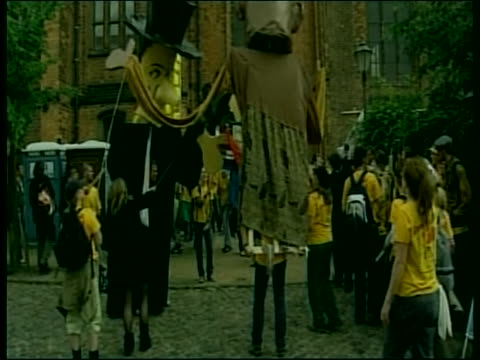 protesters wear costumes as they demonstrate in the 2007 g8 summit - (war or terrorism or election or government or illness or news event or speech or politics or politician or conflict or military or extreme weather or business or economy) and not usa stock-videos und b-roll-filmmaterial