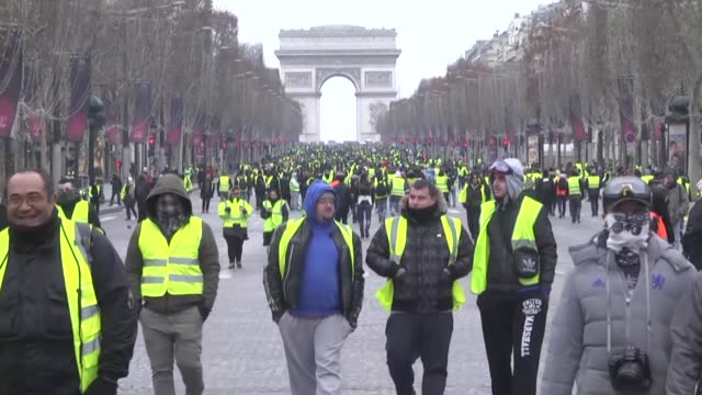 protesters wearing yellow vests stage a demonstration on december 15, 2018 in paris, france. at least 25 people have been arrested in french capital... - politics stock videos & royalty-free footage