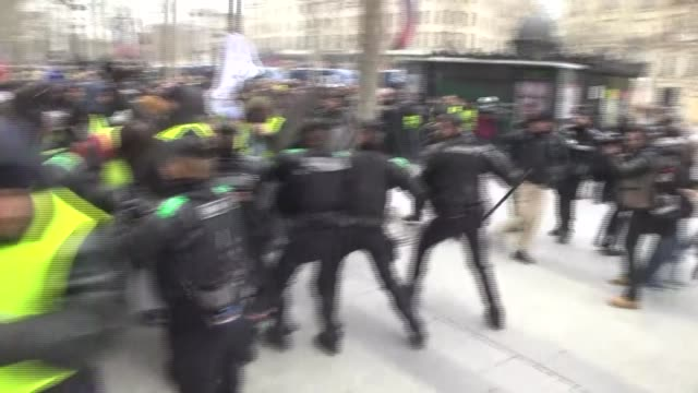 Protesters wearing 'yellow vests' stage a protest against fuel tax hikes and rising costs of living on the Champs Elysees in Paris France on December...