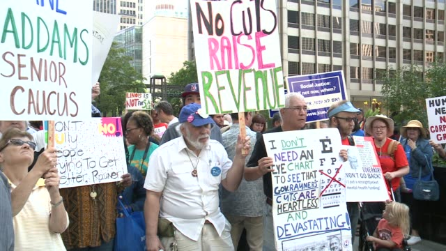 stockvideo's en b-roll-footage met protesters were arrested when senior citizens concerned about state funding for the elderly blocked north michigan avenue on august 24, 2015. they... - alcoholtest