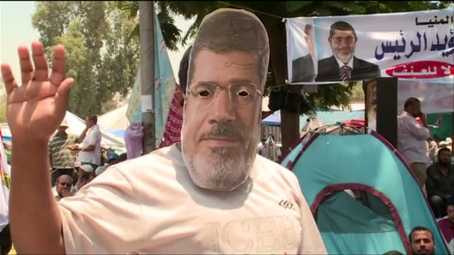 protesters who support president mohamed morsi gather in opposition to the 2013 egyptian military coup - (war or terrorism or election or government or illness or news event or speech or politics or politician or conflict or military or extreme weather or business or economy) and not usa stock videos & royalty-free footage