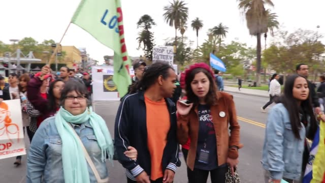 protesters will gather at macarthur park on tuesday may 1st at 4pm for a rally and march to la city hall for worker and immigrant rights - may day international workers day stock videos & royalty-free footage
