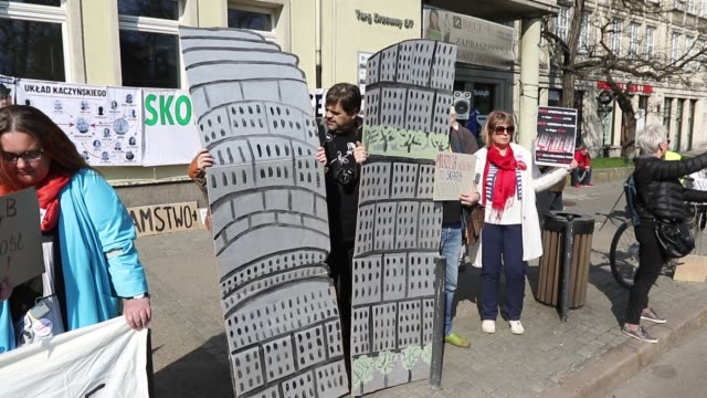 Protesters with a symbolic two towers which Jaroslaw Kaczynski wanted to build in Warsaw as a monument of his late twin brother are seen in Gdansk...