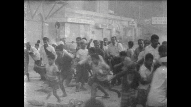 protesters with banners marching down the streets of aden protesting un interference / debris fire in the streets / tanks race down the street,... - 1967 bildbanksvideor och videomaterial från bakom kulisserna
