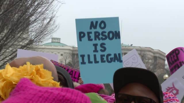 WGN Protesters with Signs at Rally before Women's March in Washington DC on Jan 21 2017