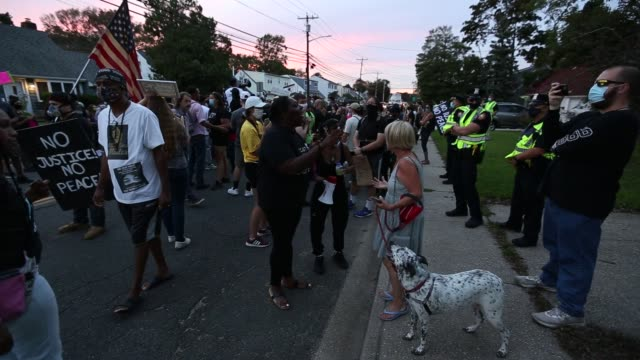 protesters with the black lives matter movement march through long island following the shooting of a black man by police officer in kenosha,... - ウィスコンシン州点の映像素材/bロール
