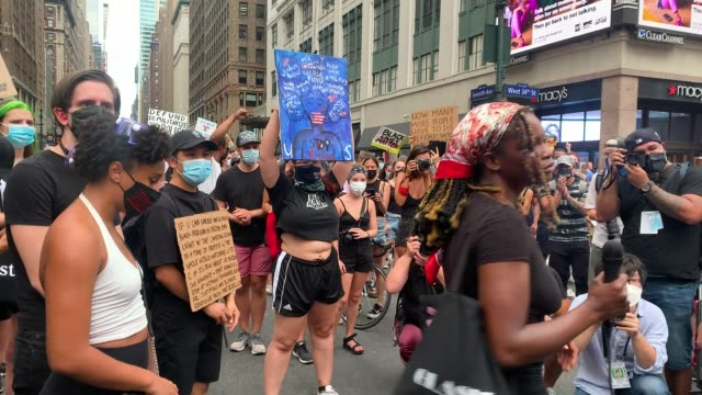 protesters with the black lives matter movement march through manhattan following the shooting of a black man by a white police officer in kenosha,... - ウィスコンシン州点の映像素材/bロール