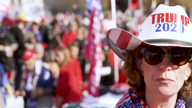 protesting the 2020 us presidential elections thousands of president donald trump supporters rally and march in freedom plaza in downtown washington... - cowboy hat stock videos & royalty-free footage