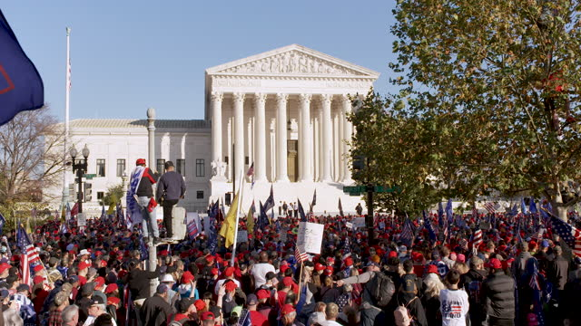 protesting the 2020 us presidential elections thousands of president donald trump supporters rally and march to the u.s. supreme court in downtown... - 米連邦最高裁判所点の映像素材/bロール