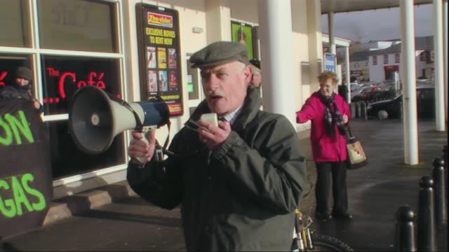 MS Protestor shouting through bullhorn, County Maigh Eo, Connacht, Ireland