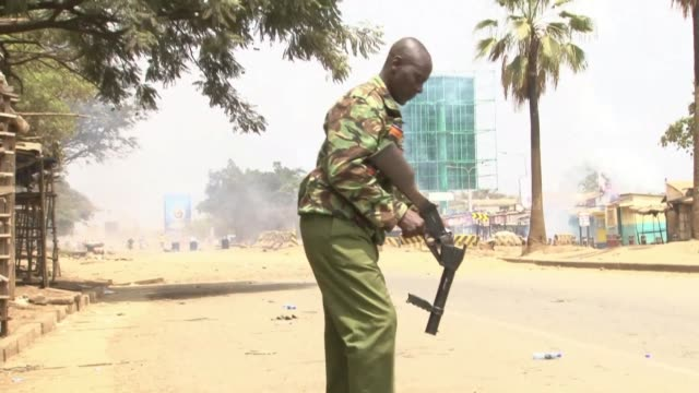 Protestors and police clash after a Kenyan government critic Miguna Miguna appeared in court Tuesday to face charges related to the mock inauguration...
