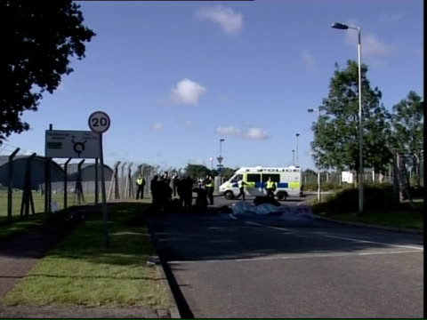 protestors at biggin hill and farnborough; england: hampshire: farnborough air field: ext environmental protestors sitting and standing in road at... - biggin hill stock videos & royalty-free footage