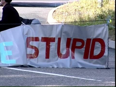 protestors at biggin hill and farnborough; protestors sitting in road and plane stupid banner - biggin hill stock videos & royalty-free footage