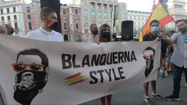 protestors attending a demonstration at the office of the catalonian government in madrid convened by la falange and other far-right political... - スペイン国旗点の映像素材/bロール