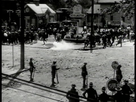 protestors carrying injured bleeding worker running down sidewalk. protestors on street running from tear gas line of national guardsmen fg. national... - 1935 stock videos & royalty-free footage