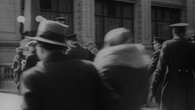 vídeos de stock e filmes b-roll de ws protestors clashing  with police  / united states - 1930