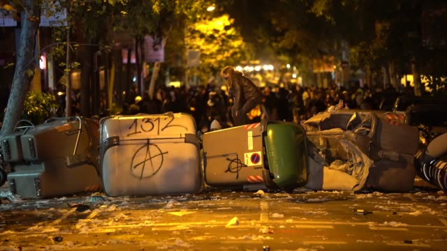 protestors create a barricade with trash bins as they clash with police on october 16, 2019 in barcelona, spain. earlier in the week, the spanish... - barcelona spain stock videos & royalty-free footage