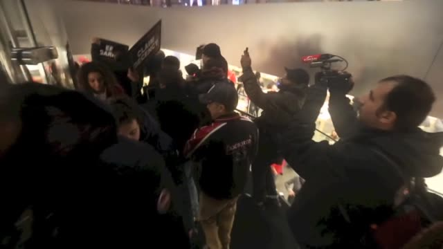 protestors demonstrate against a grand jury's decision not to indict the police officer involved in the death of eric garner in new york united... - markenname stock-videos und b-roll-filmmaterial