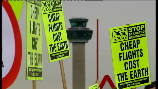 protestors demonstrate against stansted airport expansion protestros carrying banners reading 'save hatfield forest' 'stop bristol airport expansion'... - thatched roof stock videos and b-roll footage