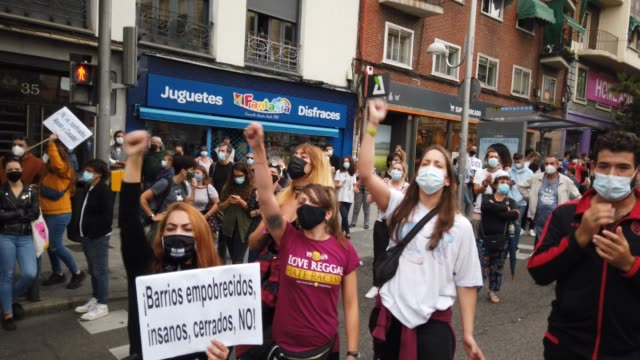 protestors extend their arms and chant during a demonstration, in the vallecas neighborhood, against the measures imposed by the capital's regional... - number 2 stock videos & royalty-free footage