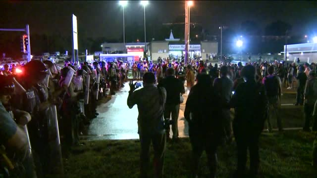 KTVI Protestors Face Line Of Police Officers At Mike Brown Shooting Anniversary Protests on August 9 2015 in Ferguson Missouri