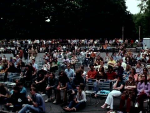 protestors gather before stage upon which vanessa redgrave and mia farrow stand at antiwar demonstration 1971 - mia farrow stock videos & royalty-free footage