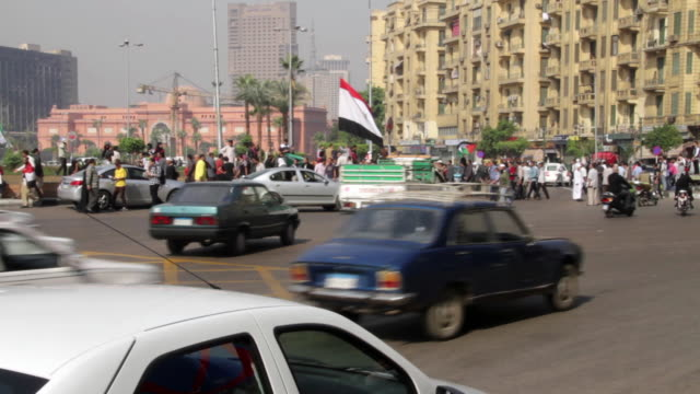 protestors gather in tahrir square. - revolution stock videos & royalty-free footage