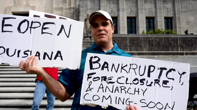 protestors gather outside the louisiana state capitol during a rally against louisiana's stayathome order and economic shutdown on april 17 2020 in... - kapitol von louisiana stock-videos und b-roll-filmmaterial