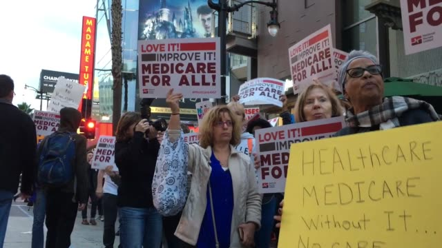 vídeos y material grabado en eventos de stock de protestors gathered to demand that trump not agree to repeal the affordable care act or attempt to refund medicare or medicaid and that he advocate... - medicare