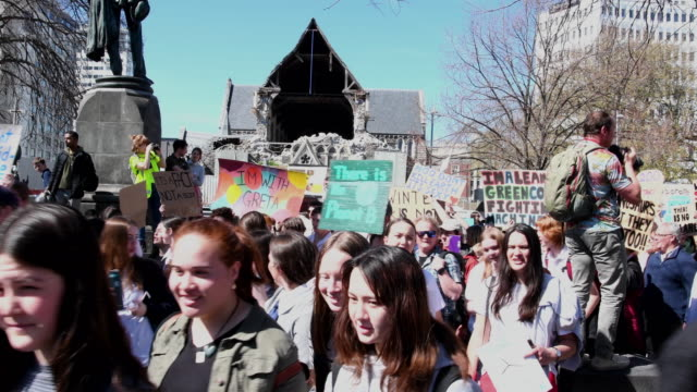 protestors hold placards during a strike to raise climate change awareness at cathedral square on september 27, 2019 in christchurch, new zealand.... - strike protest action stock videos & royalty-free footage