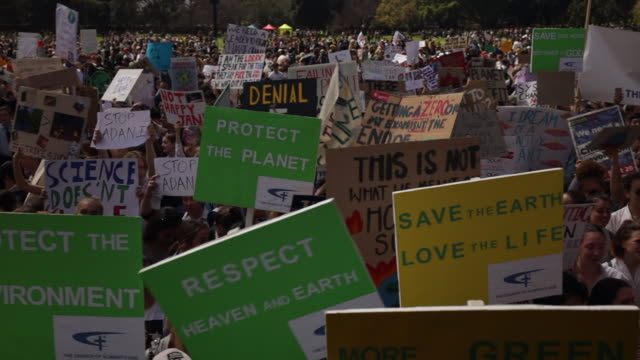 protestors hold up signs during climate strike at the domain on september 20, 2019 in sydney, australia australia. rallies held across australia are... - strike protest action stock videos & royalty-free footage