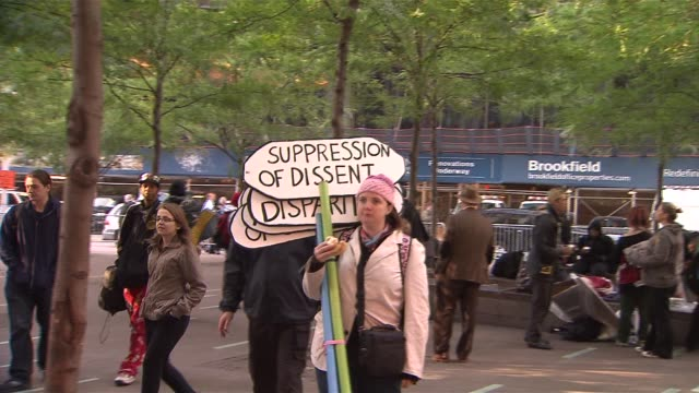 protestors join for occupy wall street's two year anniversary protestors hold up signs at zuccotti park on september 17, 2013 in new york, new york - occupy protests stock videos & royalty-free footage