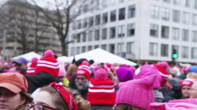 Protestors listen to speaker at Women's March in Washington DC