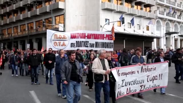 protestors march during an anti-austerity protest in athens, greece on december 3, 2015. greek public and private sector workers have walked off the... - 2015 stock videos & royalty-free footage