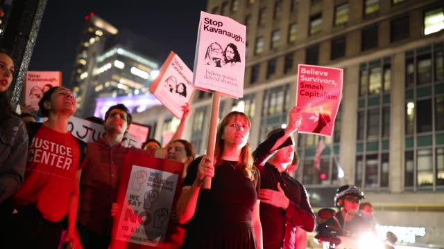protestors march through midtown manhattan as they rally against supreme court nominee judge brett kavanaugh october 1 2018 in new york city... - ノミネート点の映像素材/bロール