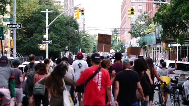 protestors march through the streets of williamsburg as bystanders watch the 55th night of the george floyd vigil at mccarren park included live... - hipster person stock videos & royalty-free footage