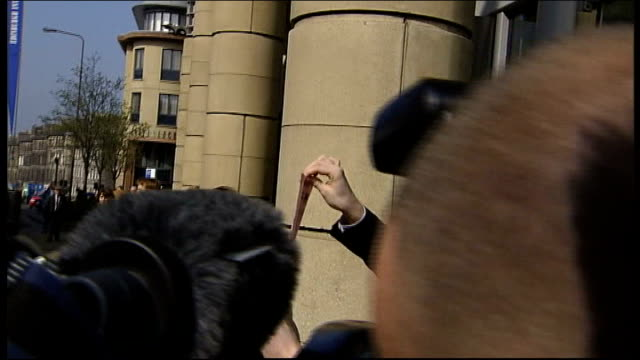 protestors outside rbs edinburgh annual general meeting; protestor wearing fred goodwin mask holding up leaflet on rbs rights issue for press - annual general meeting stock videos & royalty-free footage