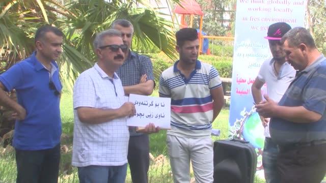protestors stage a demonstration at castle park in kirkuk, iraq on july 03, 2017 after iran deprives drinking water of iraqi kurdistan. kurdistan... - 2017 stock videos & royalty-free footage