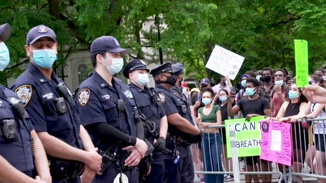 protestors stand behind steel barricades facing nypd . in the midst of the coronavirus disease pandemic demonstrators rally at foley square in... - barricade stock videos & royalty-free footage